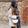 Model Wears Lisa Angel Vegan Leather Half Moon Crossbody Bag in Light Grey
