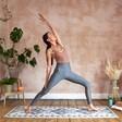 Model in Yoga Pose with Berber Mat