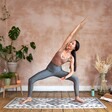 Model in Yoga Pose with Mat