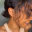 Model Wearing Gold Moon Charm Hoop Earrings