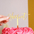 Model Holding Personalised Name Gold Acrylic Cake Topper