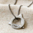 silver men's personalised double geometric charm necklace laid on hessian background