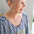 Model Wears Ladies' Personalised 60th Birthday Double Heart and Birthstone Necklace From Lisa Angel