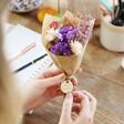 Model Holding Lisa Angel Personalised Teacher Token Dried Flower Posy