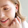 Ladies' Gold Sterling Silver Crystal Bar Huggie Hoop Earrings on Model