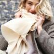 Model Wearing Recycled Blanket Scarf in Beige