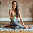 Model in Yoga Pose with Personalised Sass & Belle Mint Green Silicone Sleeve Water Bottle