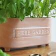 Sass & Belle Terracotta Herb Garden Trough Planter filled with herbs
