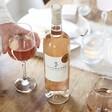 Lisa Angel Bottle of Sea Change Seahorse Provence Rosé Wine in Wine Glass