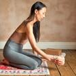 Model Holding Himalayan Rock Salt Candle Holder with Yoga Mat