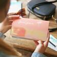 Model Holding Personalised Birth Flower Slim Iridescent Travel Wallet