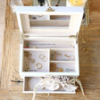 Inside of Embroidered White Jewellery Box with Drawers