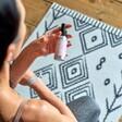 Yoga Essentials Kit Mat Spray Held by Model