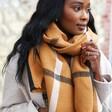 Model Wears Check Blanket Scarf in Light Brown from Lisa Angel