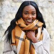 Model Wearing Check Blanket Scarf in Light Brown looking at camera