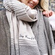 Close up of model wearing Personalised Asymmetrical Striped Blanket Scarf in Beige