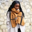 Lisa Angel Personalised Embroidered Check Blanket Scarf in Light Brown Worn by model looking off to the side