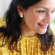 Model Wearing Double Heart Drop Earrings in Silver and Gold