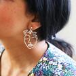 Silver Laurel Leaf Face Drop Earrings on Model