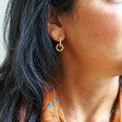 Twisted Hanging Hoop Earrings in Silver and Gold on Model