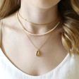 Ladies' Gold Shell Necklace on Model