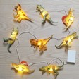 Lisa Angel House of Disaster Natural Dinosaur String Lights