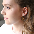 Tortoiseshell Winking Face Drop Earrings on Model
