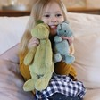 Lisa Angel with Jellycat Bashful Dino Soft Toy and Dragon Soft Toy