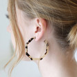 Hexagonal Tortoiseshell Hoop Earrings on Model