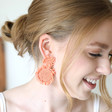 Small Beaded Flowers Drop Earrings in Pink on Model