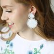 Teens Small Beaded Flowers Drop Earrings in White on Model