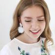 Small Beaded Flowers Drop Earrings in White on Model