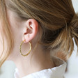 Gold Bamboo Hoop Earrings on Model