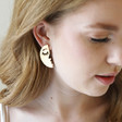 Teen's Half Face Drop Earrings in Brushed Gold on Model