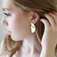 Half Face Drop Earrings in Brushed Gold on Model