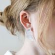 Half Face Drop Earrings in Brushed Silver on Model