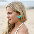 Gold Half Circle Tassel Stud Earrings in Teal on Model