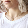 Starfish Pendant Necklace in Gold on Model