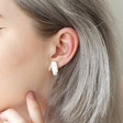 Silver Hand Stud Earrings on Model