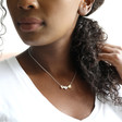 Brushed Mixed Metal Large Triple Heart Necklace on Model