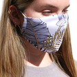 Model Wears Lisa Angel Ladies' Navy and Gold Leaf Fabric Face Mask with Filters
