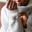 'Be Brave' Meaningful Word Bangle in Rose Gold on Model