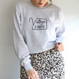 Personalised 'Vintage Year' Unisex Sweatshirt in Grey on Female Model