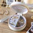Inside of Personalised Grey Rainbow Name Mini Round Travel Jewellery Case