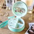 Inside of Personalised Turquoise Rainbow Name Mini Round Travel Jewellery Case