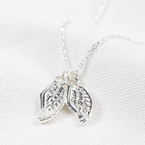 Double Wing Charm Necklace in Silver