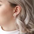 Hammered Interlocking Hearts Drop Earrings in Silver on Model