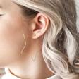 Sparkle Cut Star Hoop Earrings in Gold on Model