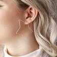 Sparkle Cut Star Hoop Earrings in Silver on Model