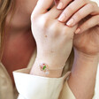 Model Wearing Lisa Angel Ladies' Silver Pressed Birth Flower Charm Bracelet with Birthstone Charm